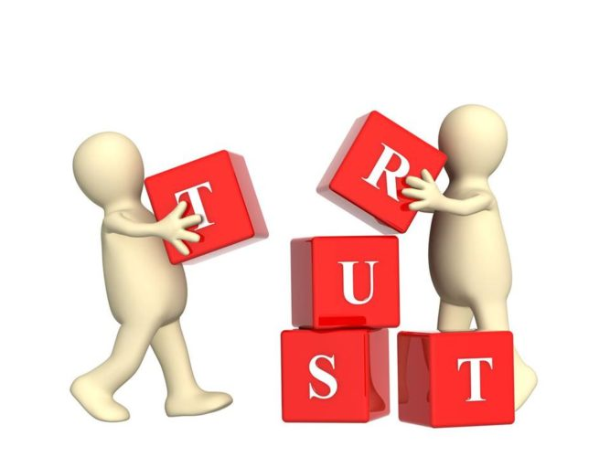 Customers Need to Trust: Image is the word trust spelled w/ building blocks.
