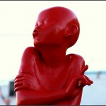 Rebuilding Trust: Image is statue of child hugging itself.