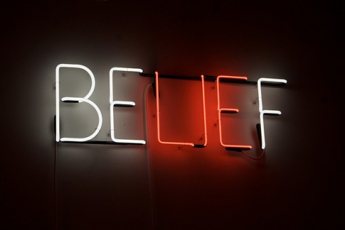 "Customer Experience Beliefs: Image is the neon sign ""belief""."
