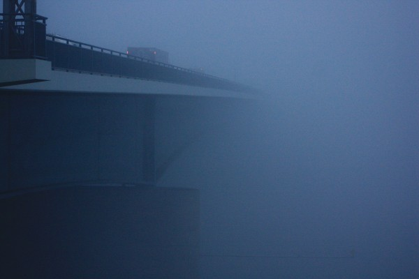 Leadership Self-Awareness: Image is a bridge occluded with dense fog.