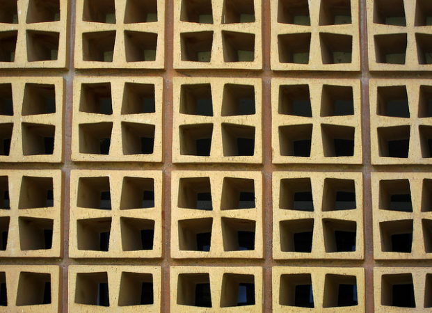 Business Empathy: Image is cinder blocks arranged in pattern with openings for change.