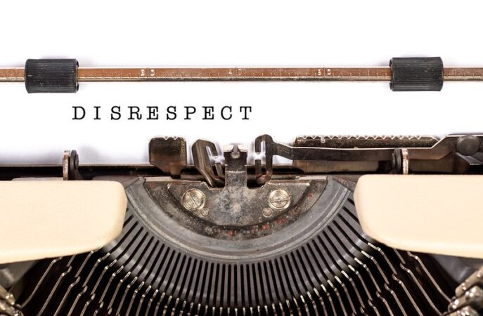 Disrespect People: Image is the word disrespect typed on a manual typewriter.