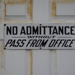 Leadership Bias: Image is a closed door w/ sign that says no admittance without pass from office.