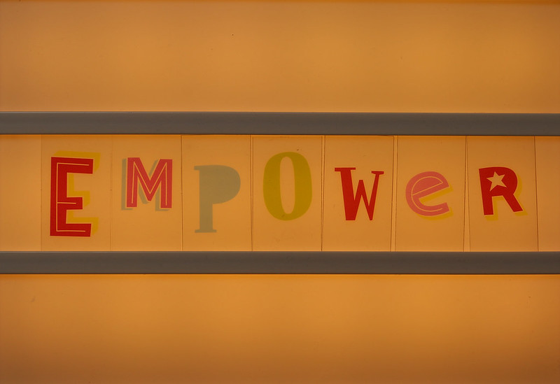 Empowerment Essentials: Image is the word empower