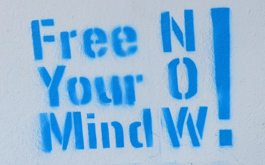 Difficult Customer Moments: Image is sign that says free your mind now!