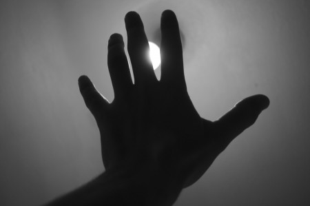 Be Treated Respectfully: Image is hand up in front of the sun.
