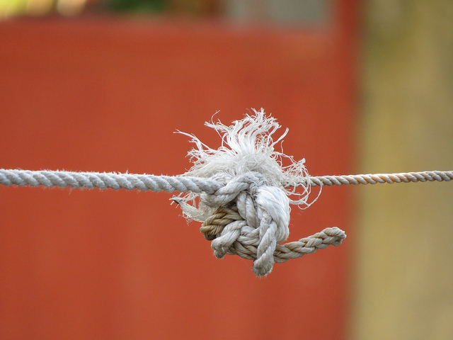 Hard Human Consequences: Image is frayed rope knot.