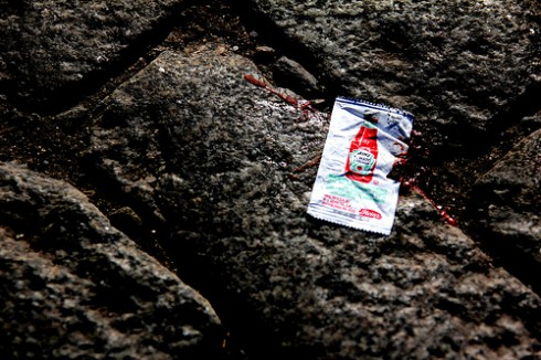 True Customer Experience Leadership:; Image is an empty packet of ketchup.