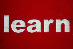 Paying Your Dues: Image is sign that says learn.