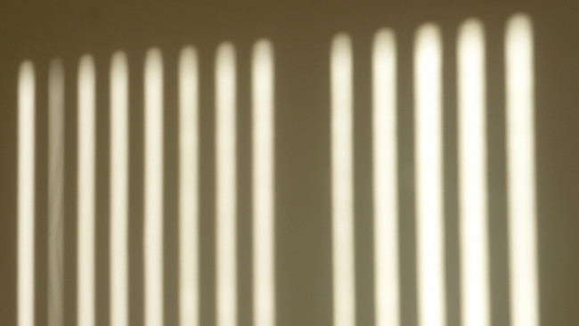 Leadership Assumptions: Image is shadows of window blinds.