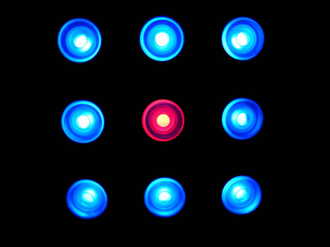Leadership Attack Responses: Image is round blue lights and one red one in the middle.