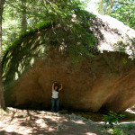 Leadership Unfairness: Image is giant boulder w/ person standing underneath.