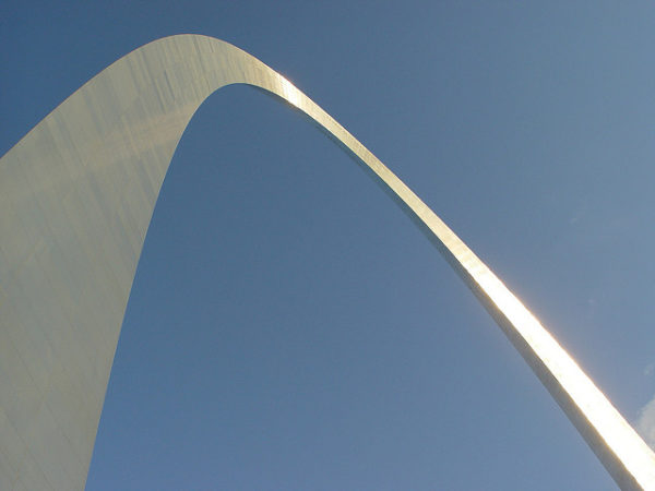 Leading Volunteers: Image is arch in a blue sky.