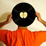 Listening Excellence: Image is Man w/ Record Album w/ ears in the middle.