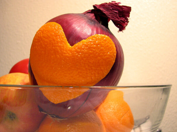Misguided Leadership Belief: Image is an onion w/ an orange peel attached in the shape of a heart.