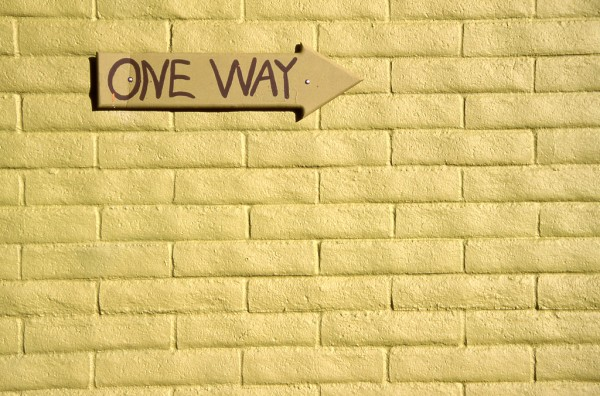 Giant Communication Blunder: Image is brick wall w/ a one way sign on it.