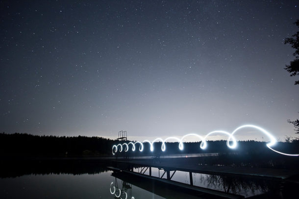 People Skills Loser Word: Image is electrical wave over a bridge.