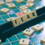 Presuming Fear: Image is Scrabble Tiles Spelling Fear