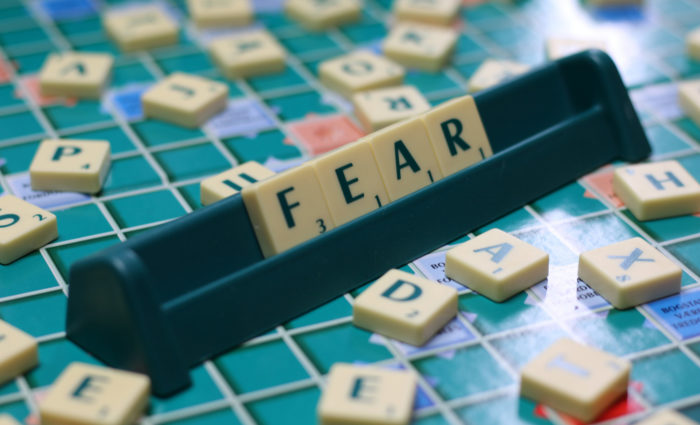 Presuming Fear: Image is Scrabble Tiles Spelling Fear