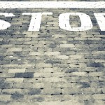 Customer Service Defensiveness: Image is the word STOP.
