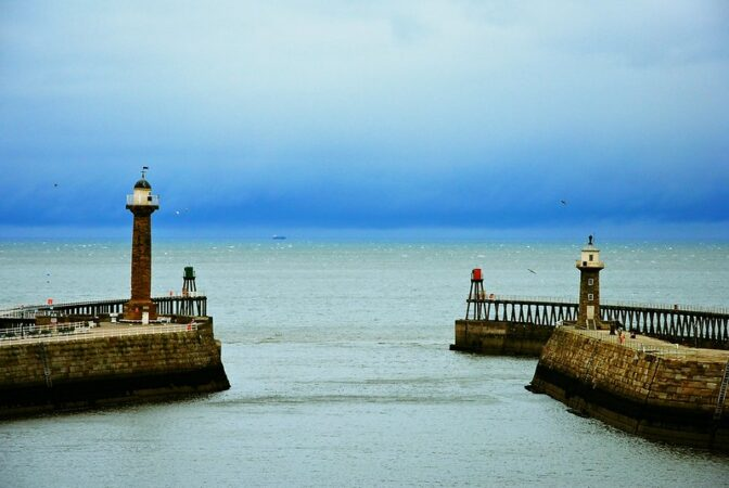 Sexual Harassment Prevention: Image is open harbor w/ two lighthouses.