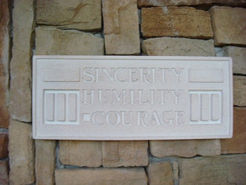 Leadership Sincerity: Image is stone w/ words sincerity humility courage.