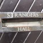 "Modern People Skills: Image is sign ""Strangers Hall"""