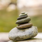 Team Harmony: Image are zen rocks stacked but tipping.