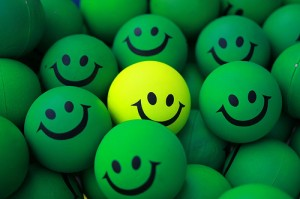 Customer Experience; Image are smiley faces w/ one different color.