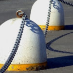 Unempathetic Leadership & Teamwork Replies: Image is concrete bells chained together.