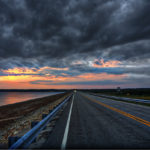 Workplace Conflict Resolution: IMage is a road headed into stormy skies.
