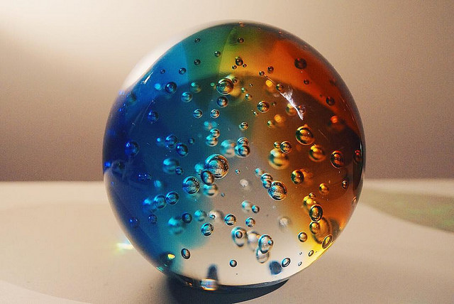 Workplace Inclusion: Image is large glass sphere w/ different colors.