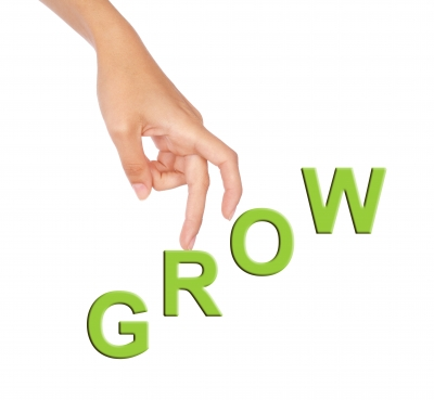 True Employee Engagement: Image is the word Grow w/ fingers walking up the letters.
