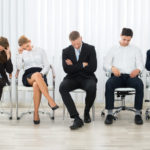Leaders Foolishly Minimize Employees: Image is diverse disengaged employees.