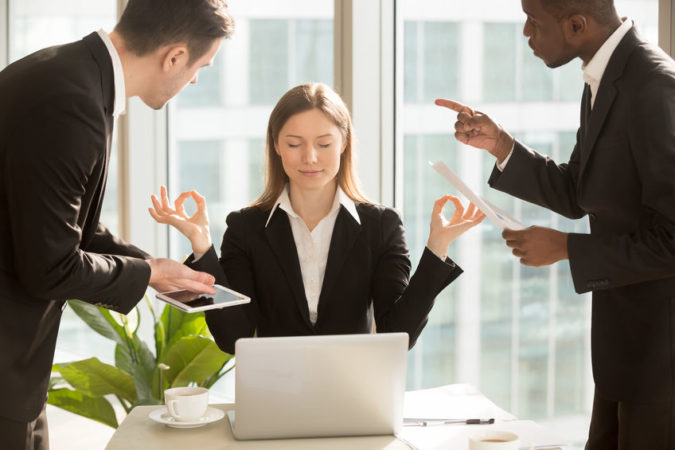 Leadership Listening Tips: Image is boss holding up arms for pause to two employees