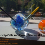Leadership Calls: Image is paper weight on desk w/ pens sticking out of it.