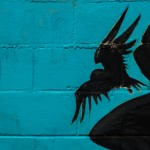 Creepy Communication: Image is black raven against shadow blue.