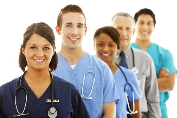 Outstanding Patient Experience: Image is diverse healthcare professionals.