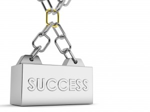 Customer Service Mindset: Image is chain with engraved weight that says success.