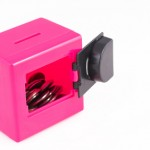 Personality Types: Image is a toy safe w/ door open and coins.