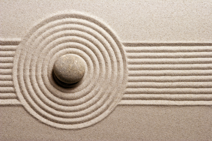 Leading Change: Image is a Stone Rippling Even Trails in Sand