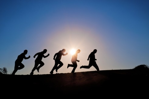 Leadership Mirage: Image is Runners in setting sun.
