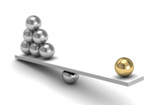 Empathy and Humility: Image is gold ball balancing many silver balls