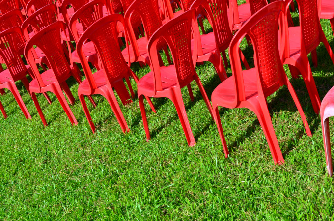 Business Lessons Learned: Image is many red chairs lined up perfectly.