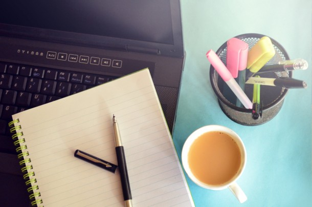 Entrepreneurial Success: Image is laptop, pen, paper, coffee cup etc...
